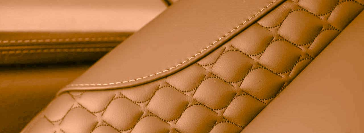 Close-up of detailed stitch patterns on interior leatherwork in Project Neptune