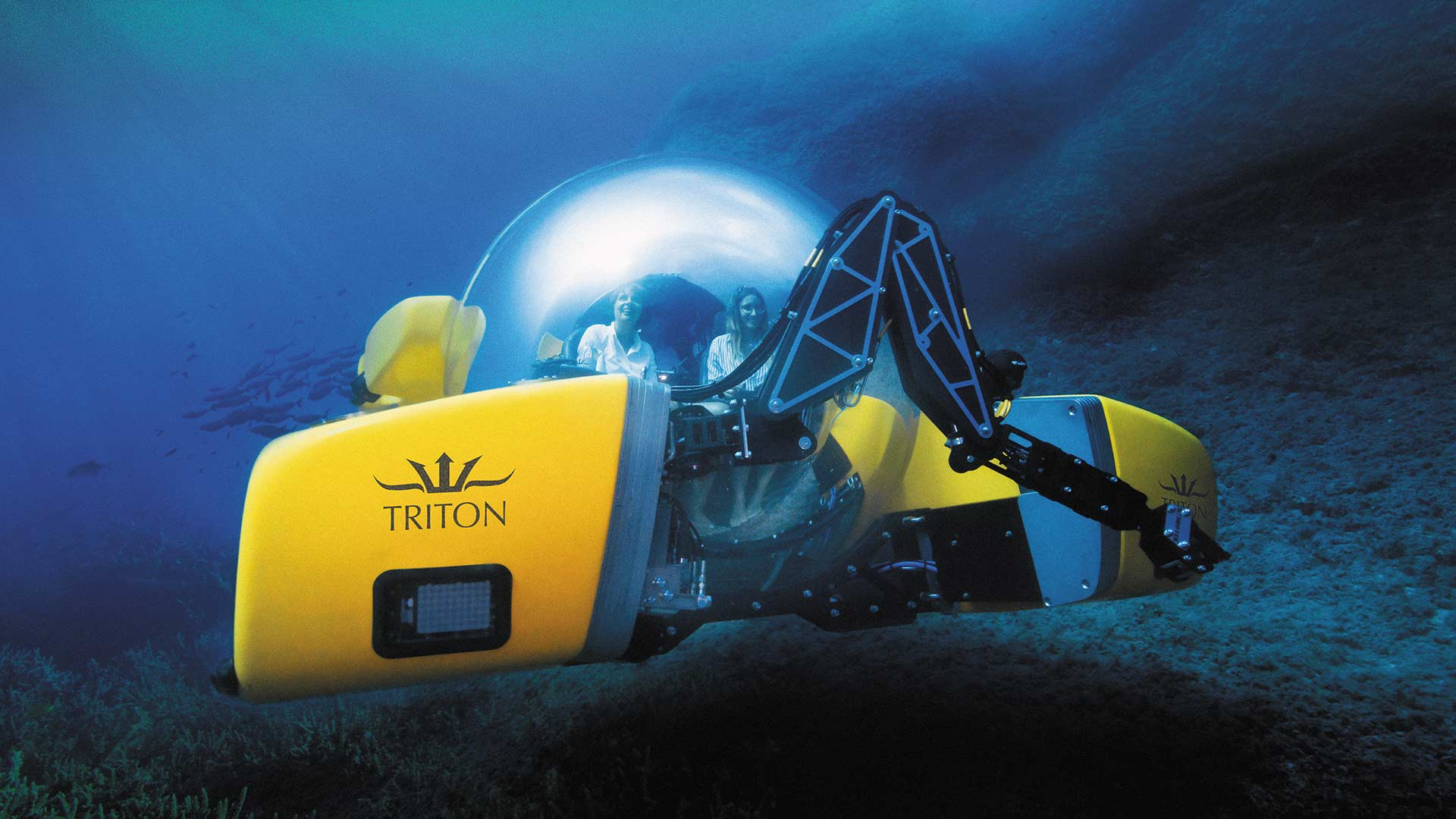 Two guests inside a submerged Triton 1650/3 LP leisure sub