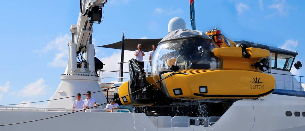 Triton submersible launching from an Expedition yacht