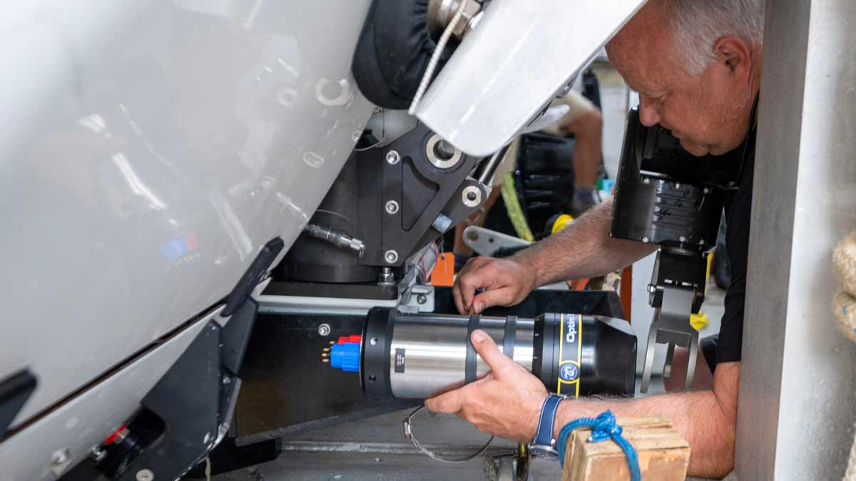 Triton Engineer works on HD camera attached to Full-Ocean-Depth-capable submersible