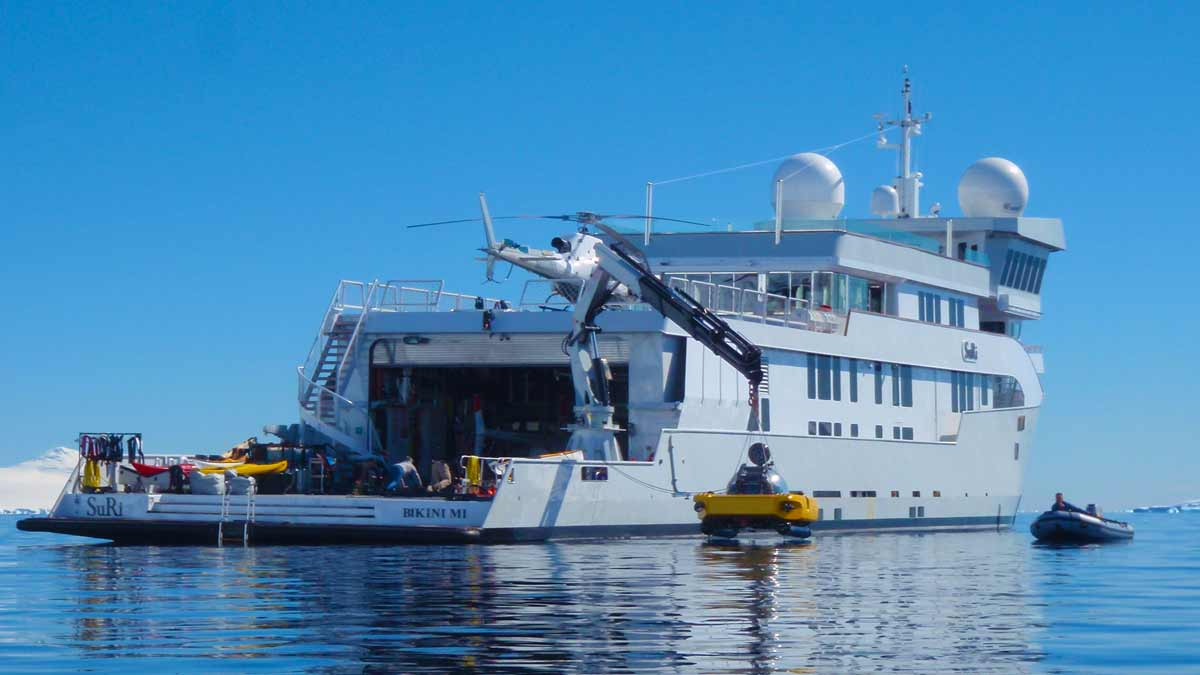 Expedition yacht with helicopter and Triton Submersibles onboard.