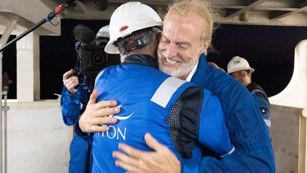 Triton customer Victor Vescovo embraces Triton Submarines' Patrick Lahey following record-breaking dives.