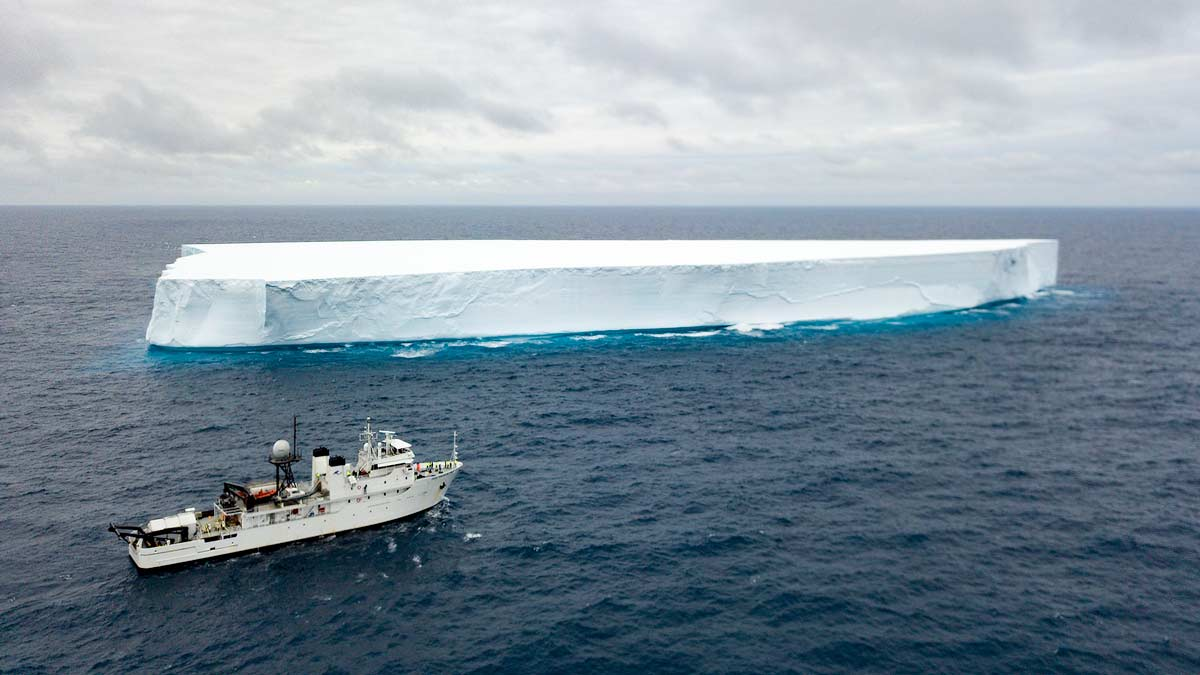 Triton Hadal Exploration System pictured by large iceberg In Southern Ocean