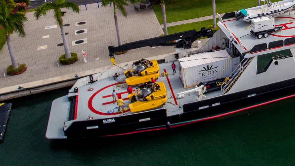 Large yacht with two Triton submersibles embarked