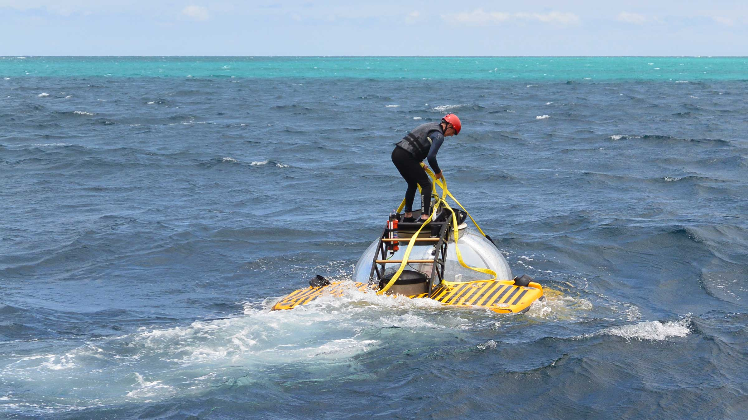 Demonstrating Triton's surface stability by standing on pontoons during surface movements in choppy waters