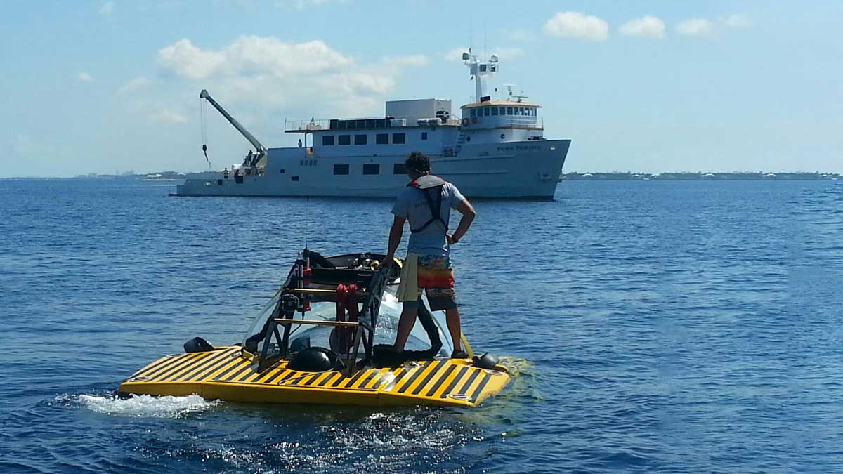Demonstrating Triton's surface stability by standing on pontoons during surface ops
