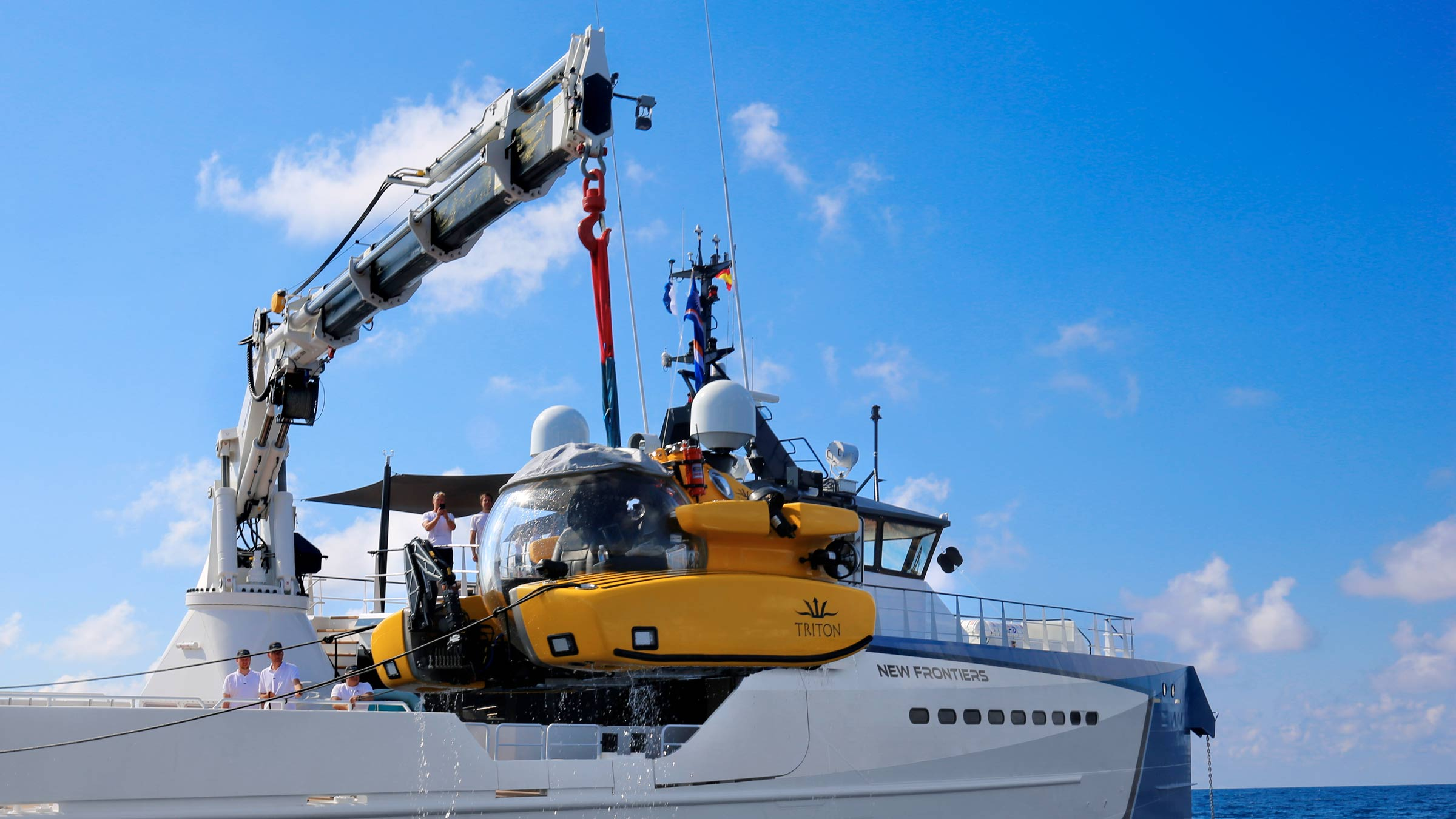 Triton submersible being launched by crane